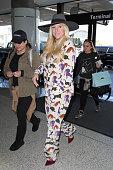 Kesha is seen at LAX on November 25 2015 in Los Angeles California