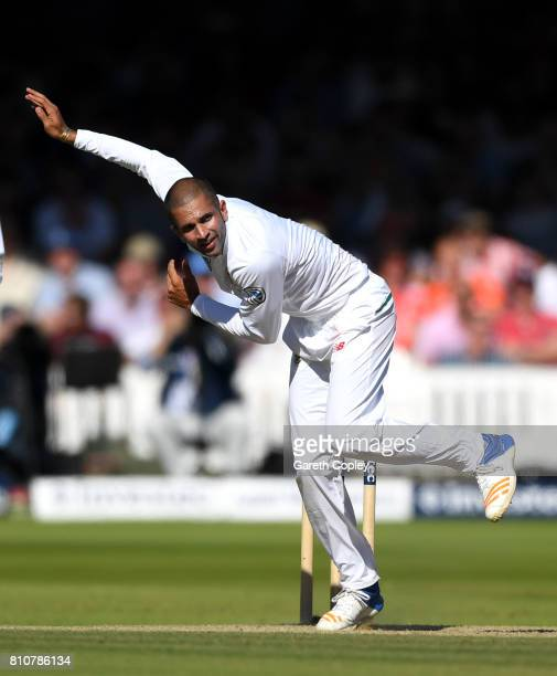 Keshav Maharaj of South Africa bowls during day three of the 1st Investec Test match between England and South Africa at Lord's Cricket Ground on...