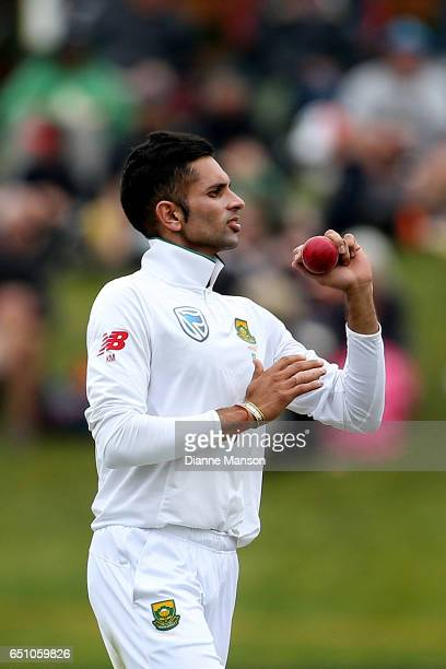 Keshav Maharaj of South Africa bowls during day three of the First Test match between New Zealand and South Africa at University Oval on March 10...