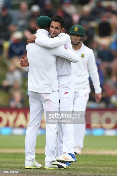 Keshav Maharaj of South Africa celebrates the dismissal of BJ Watling of New Zealand during day three of the First Test match between New Zealand and...