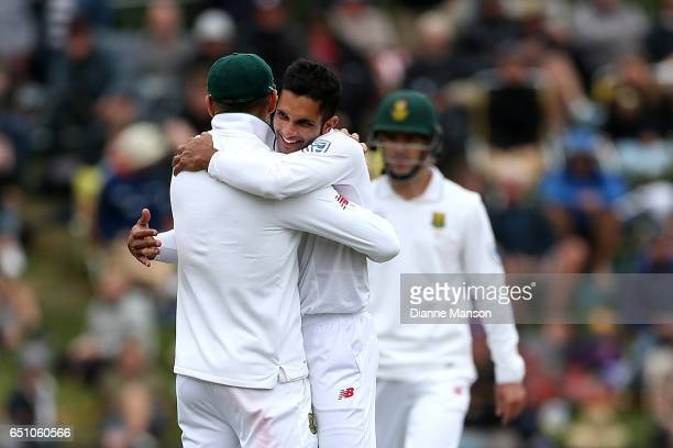 Keshav Maharaj of South Africa celebrates the wicket of BJ Watling of New Zealand during day three of the First Test match between New Zealand and...