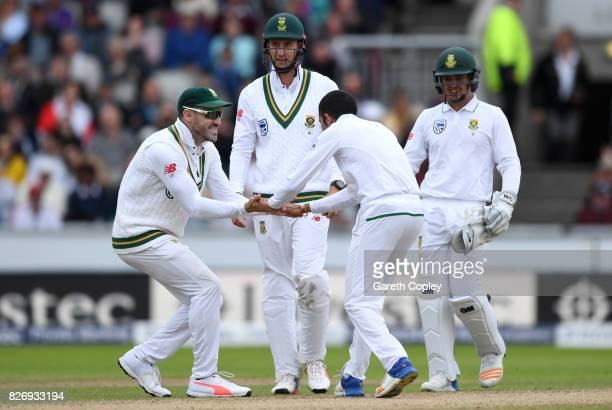 Keshav Maharaj of South Africa celebrates with Faf du Plessis after dismissing Dawid Malan of England during day three of the 4th Investec Test match...