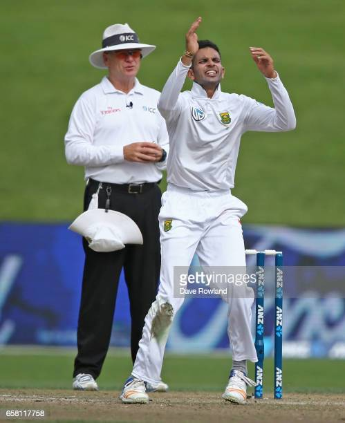 Keshav Maharaj of South Africa reacts whilst bowling during day three of the Test match between New Zealand and South Africa at Seddon Park on March...