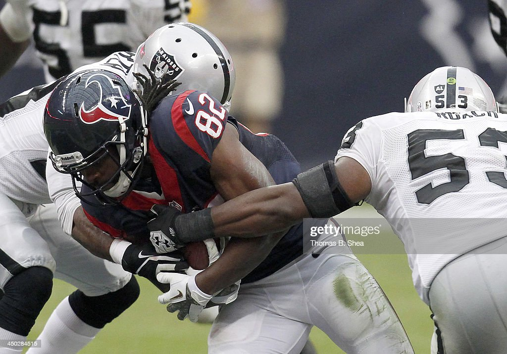 Keshawn Martin #82 of the Houston Texans is tackled by Nick Roach #53 of the Oakland Raiders on November 17, 2013 at Reliant Stadium in Houston, Texas. Raiders won 28 to 23.