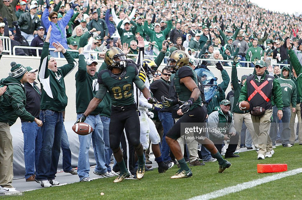 Keshawn Martin #82 of the Michigan State Spartans scores a third quarter touchdown and celebrates with teammate Fou Fonoti #51 during the game at Spartan Stadium on October 15, 2011 in East Lansing, Michigan. Michigan State defeated Michigan 28-14.
