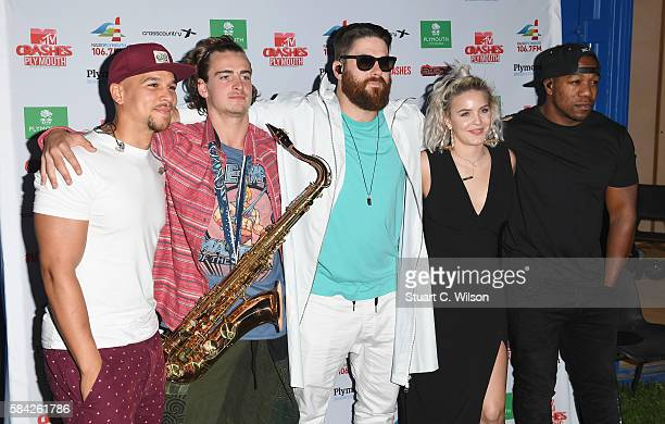 Kesi Dryden Piers Agget and DJ Locksmith of Rudimental pose with Anne Marie at MTV Crashes Plymouth at Plymouth Hoe on July 28 2016 in Plymouth...