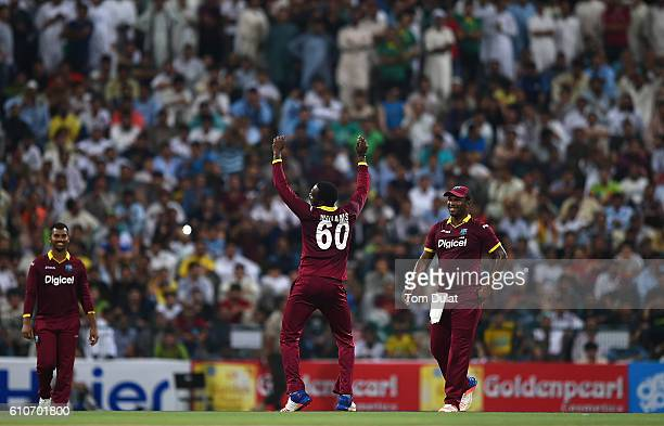 Kesrick Williams of West Indies celebrates taking the wicket of Khalid Latif of Pakistan during the third T20 International match between Pakistan...