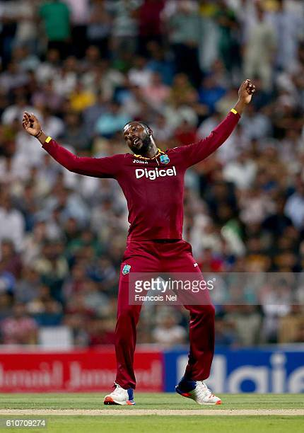 Kesrick Williams of West Indies celebratesafter taking the wicket of Khalid Latif of Pakistan during the third T20 International match between...