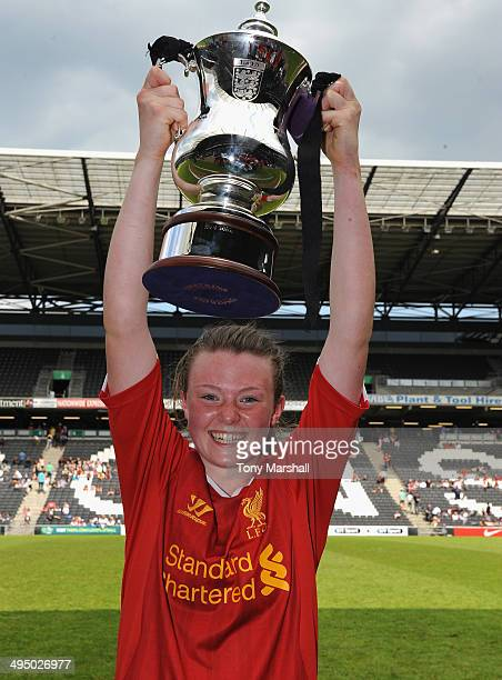 Kess Elmore of Liverpool Ladies scorer of th only goal lifts thr trophy during the FA Girl's Youth Cup Final between Everton Ladies and Liverpool...
