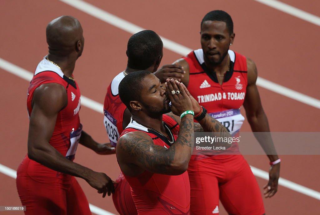 Keston Bledman Marc Burns Emmanuel Callender and Richard Thompson of Trinidad and Tobago celebrate winning bronze after the Men's 4 x 100m Relay...