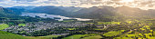 Panoramic view of Keswick and Derwentwater with beautiful light shining through clouds.