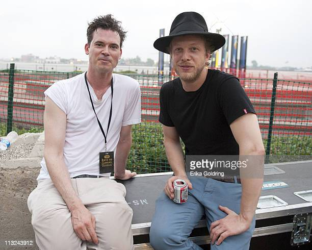 Ketch Secor of Old Crow Medicine Show chats backstage with Ted Dwane of Mumford Sons at Woldenberg Park on April 27 2011 in New Orleans Louisiana