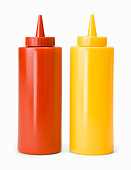 Ketchup and mustard bottles, against white background, close-up
