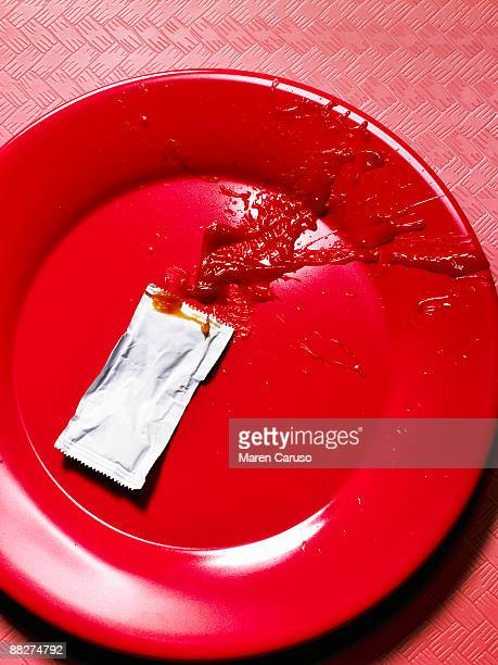Ketchup splat on a red plate