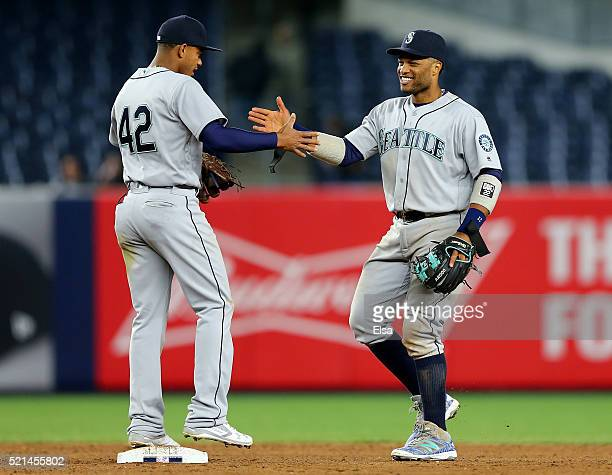 Ketel Marte and Robinson Cano of the Seattle Mariners celebrate the 71 win over the New York Yankees at Yankee Stadium on April 15 2016 in the Bronx...