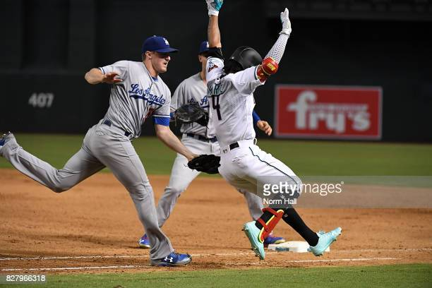 Ketel Marte of the Arizona Diamondbacks is tagged out by Ross Stripling of the Los Angeles Dodgers at first base during the eighth inning at Chase...