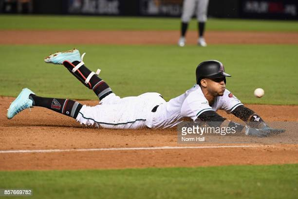 Ketel Marte of the Arizona Diamondbacks slides into third base during the bottom of the second inning of the National League Wild Card game against...