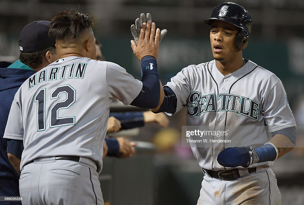 Ketel Marte #4 of the Seattle Mariners is congratulated by Leonys Martin #12 after Marte scored against the Oakland Athletics in the top of the sixth inning at the Oakland Coliseum on August 12, 2016 in Oakland, California.