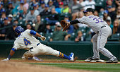 Ketel Marte of the Seattle Mariners is doubled off of first by first baseman Justin Morneau of the Colorado Rockies on a fly ball out off the bat of...