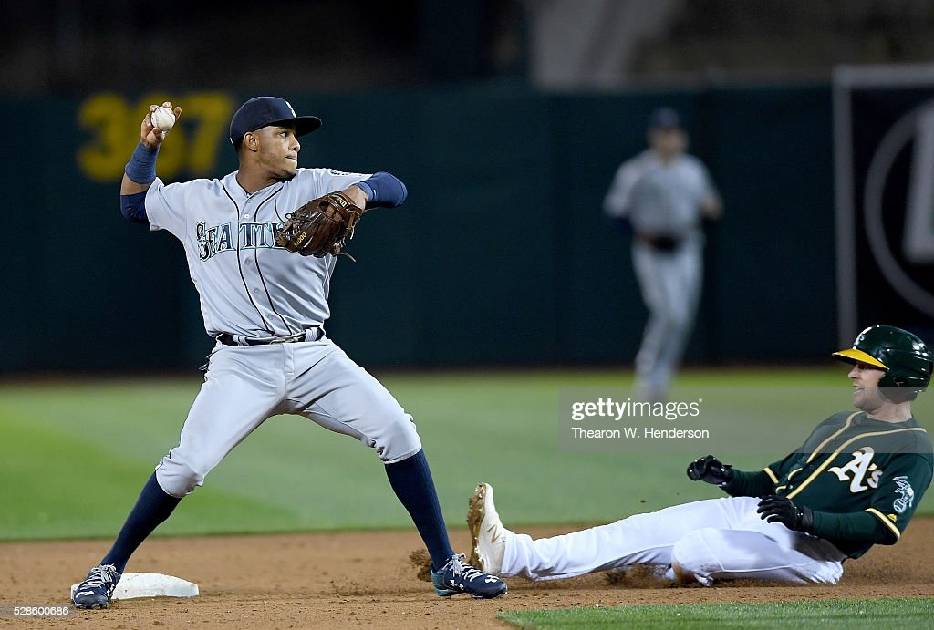 Ketel Marte #4 of the Seattle Mariners looks to throw over the top of sliding <a gi-track='captionPersonalityLinkClicked' href=/galleries/search?phrase=Jed+Lowrie&family=editorial&specificpeople=4949369 ng-click='$event.stopPropagation()'>Jed Lowrie</a> #8 of the Oakland Athletics in the bottom of the six inning at O.co Coliseum on May 3, 2016 in Oakland, California.