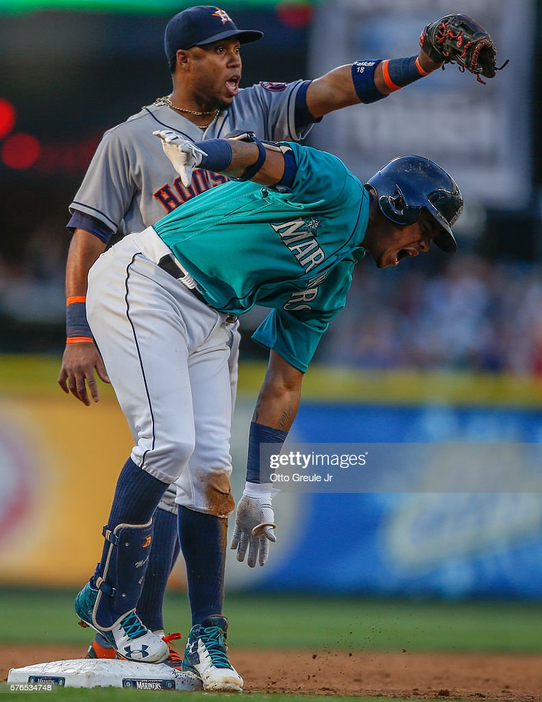 Ketel Marte #4 of the Seattle Mariners reacts after being tagged out by third baseman Luis Valbuena #18 of the Houston Astros in the second inning at Safeco Field on July 15, 2016 in Seattle, Washington. Marte was initially ruled safe but the call was reversed following a replay review.