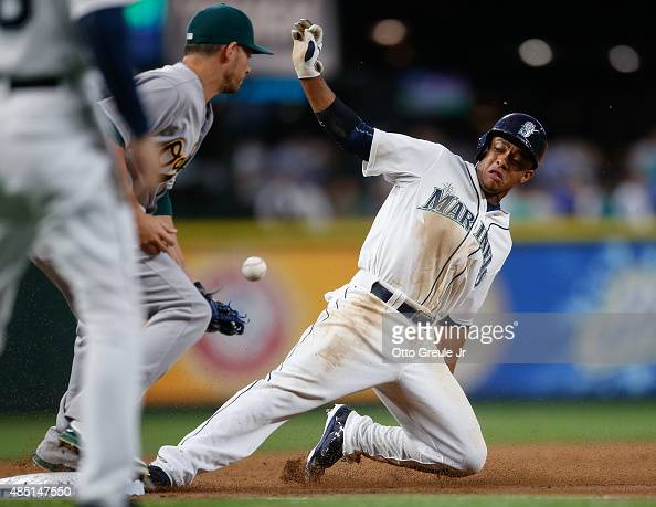 Ketel Marte of the Seattle Mariners steals third base against Danny Valencia of the Oakland Athletics in the third inning at Safeco Field on August...
