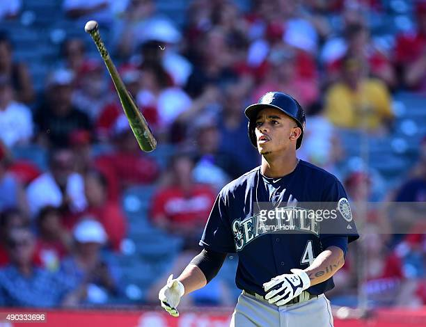 Ketel Marte of the Seattle Mariners tosses his bat in reaction to his strikeout during the eighth inning against the Los Angeles Angels at Angel...