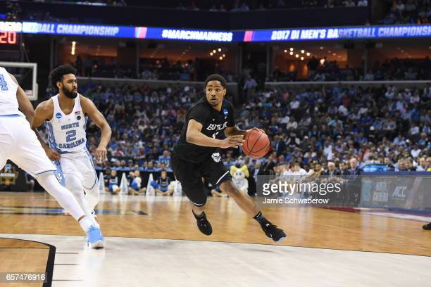 Kethan Savage of Butler University dribbles up the court against Joel Berry II of the University of North Carolina during the 2017 NCAA Men's...