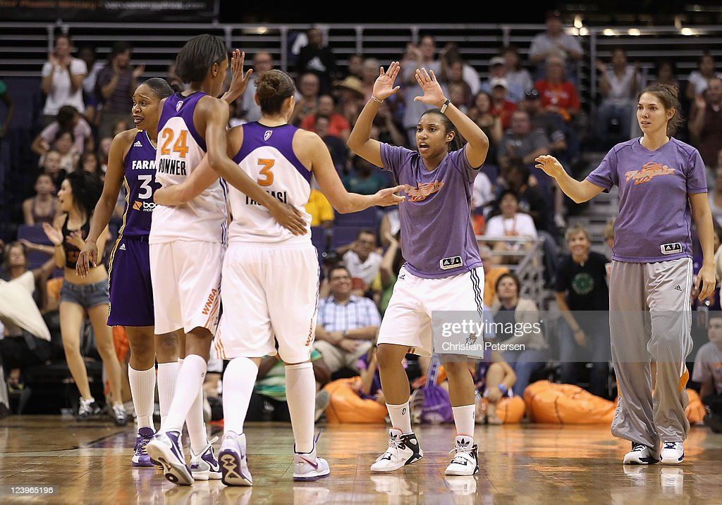 Ketia Swanier and Sidney Spencer of the Phoenix Mercury celebrate with teammates following the WNBA game against the Los Angeles Sparks at US Airways...