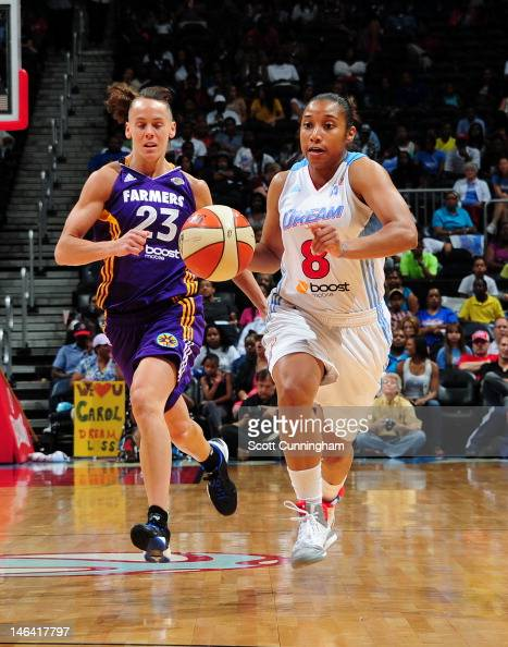 Ketia Swanier of the Atlanta Dream drives against Coco Miller of the Los Angeles Sparks at Philips Arena on June 15 2012 in Atlanta Georgia NOTE TO...