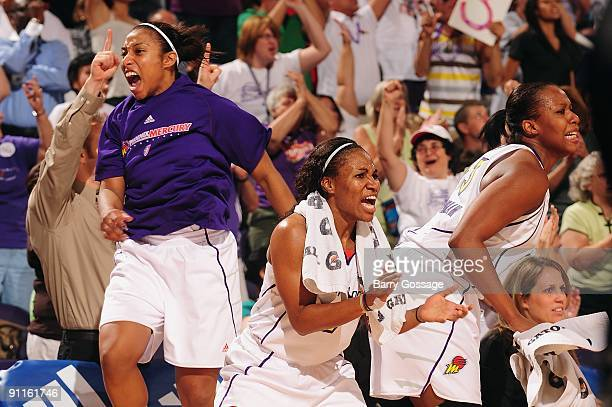 Ketia Swanier Temeka Johnson and Le'coe Willingham of the Phoenix Mercury celebrate on the sideline during Game Three of the WNBA Western Conference...