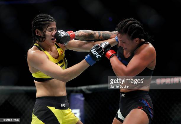 Ketlen Vieira battles Ashlee EvansSmith during their Women's Bantamweight bout on UFC Fight Night at the Sprint Center on April 15 2017 in Kansas...