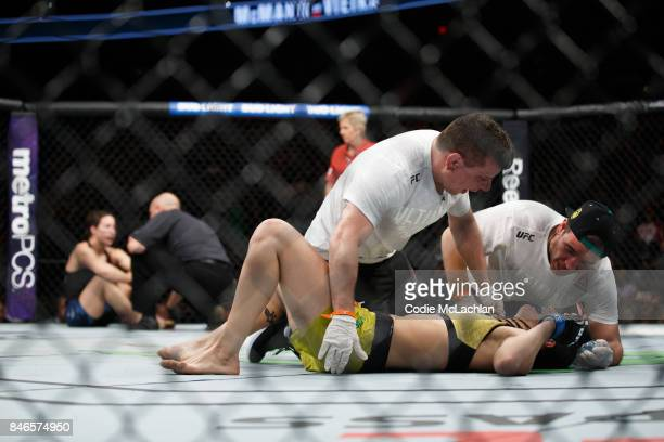 Ketlen Vieira celebrates after defeating Sara McMann during UFC 215 at Rogers Place on September 9 2017 in Edmonton Canada