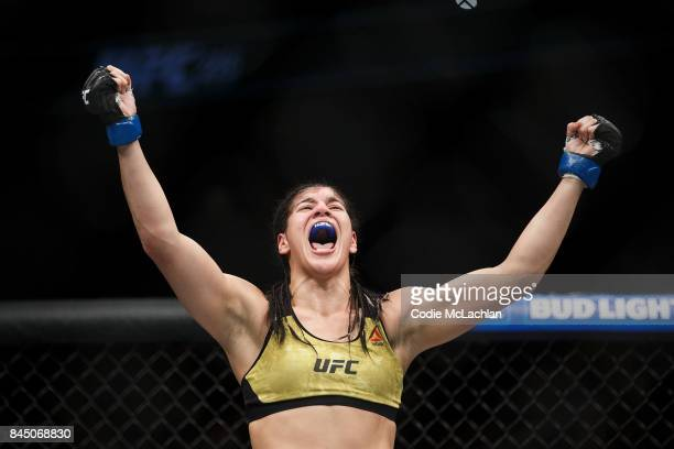 Ketlen Vieira celebrates her victory against Sara McMann during UFC 215 at Rogers Place on September 9 2017 in Edmonton Canada