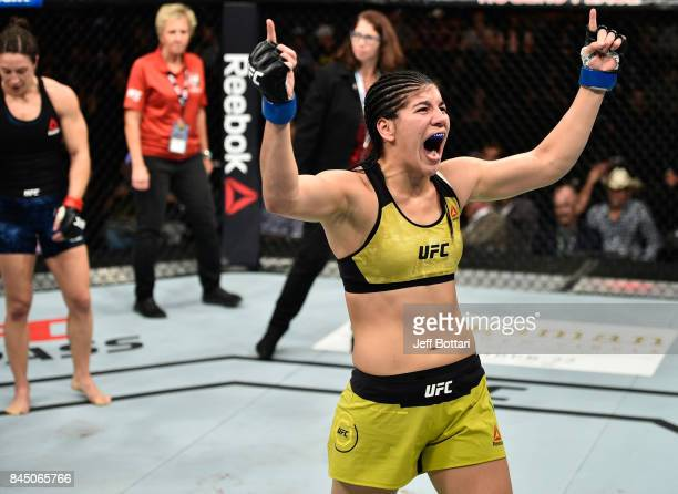 Ketlen Vieira of Brazil celebrates her submission victory over Sara McMann in their women's bantamweight bout during the UFC 215 event inside the...
