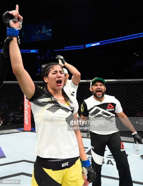 Ketlen Vieira of Brazil celebrates her victory over Ashlee EvansSmith in their women's bantamweight fight during the UFC Fight Night event at Sprint...