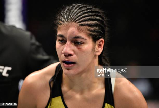 Ketlen Vieira of Brazil heads to her corner after the first round while facing Sara McMann in their women's bantamweight bout during the UFC 215...