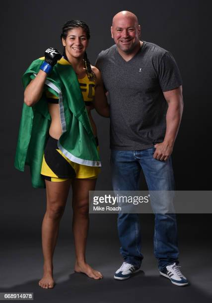 Ketlen Vieira of Brazil poses for a post fight portrait backstage with UFC President Dana White during the UFC Fight Night event at Sprint Center on...