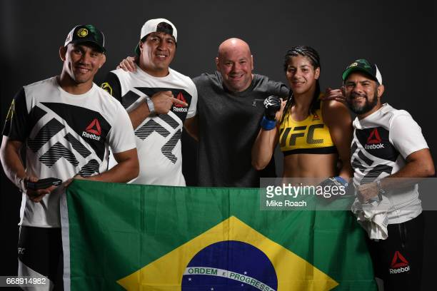 Ketlen Vieira of Brazil poses for a post fight portrait backstage with UFC President Dana White and her team during the UFC Fight Night event at...
