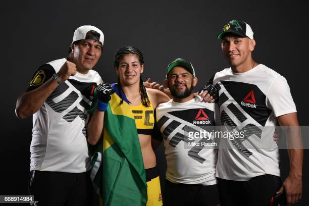 Ketlen Vieira of Brazil poses for a post fight portrait backstage with her team during the UFC Fight Night event at Sprint Center on April 15 2017 in...
