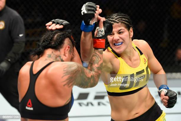 Ketlen Vieira of Brazil punches Ashlee EvansSmith in their women's bantamweight fight during the UFC Fight Night event at Sprint Center on April 15...