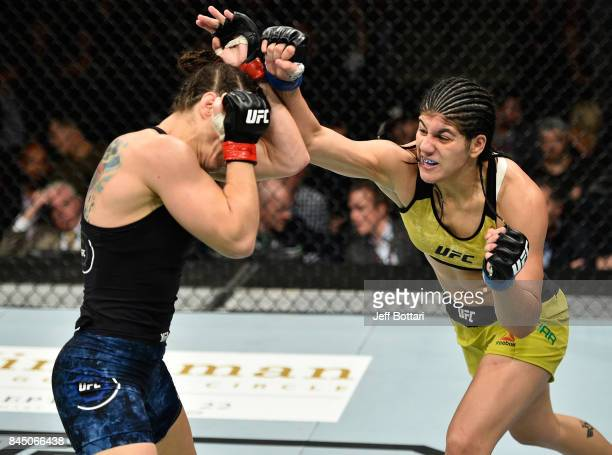 Ketlen Vieira of Brazil punches Sara McMann in their women's bantamweight bout during the UFC 215 event inside the Rogers Place on September 9 2017...