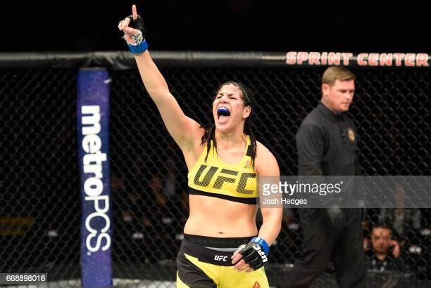 Ketlen Vieira of Brazil raises he hand and yells after facing Ashlee EvansSmith in their women's bantamweight fight during the UFC Fight Night event...
