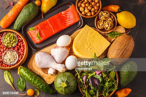 Keto (ketogenic) diet concept. Balanced low-carb food background. High protein food. Vegetables, fish, meat, cheese, nuts on a dark background. : Stock Photo