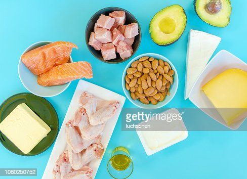 Ketogenic diet food. Low-carb food background, fish, meat, cheese, nuts, oil and butter on a blue background. mockup,  flatlay, flat lay Top view Keto diet concept. : Stock Photo