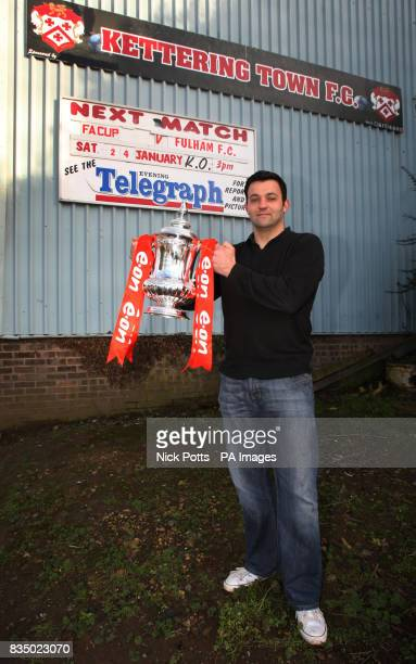 Kettering Town goalkeeper Lee Harper holds the FA Cup during the Media Day at Rockingham Road Kettering