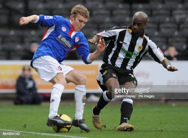 Kettering Town's Alfie Potter is tackled by Notts County's Jay Smith during the FA Cup Second Round match at Meadow Lane Nottingham