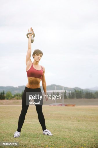 Kettlebell gym workout : Stock Photo