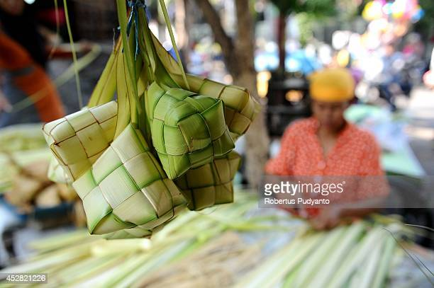 Ketupat are prepared at the traditional market as special Eid alFitr dishes on July 28 2014 in Surabaya Indonesia Muslims worldwide observe the Eid...