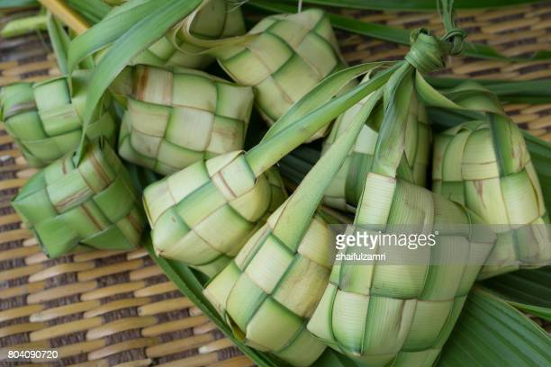 Ketupat, Kupat or Tipat is a type of dumpling made from rice packed inside a diamond-shaped container of woven palm leaf pouch. It is commonly found in Indonesia, Malaysia, Brunei and Singapore.